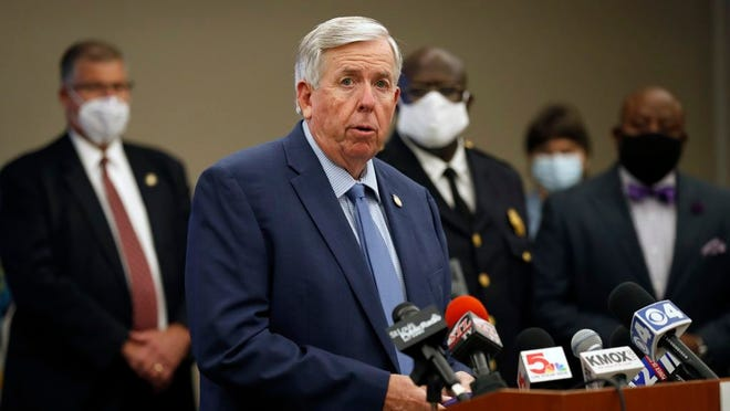 File- Missouri Gov. Mike Parson speaks during a news conference Thursday, Aug. 6, 2020, in St. Louis. Officials announced St. Louis has been added to the list of cities that will receive assistance from Operation Legend, a federal anti-crime program launched to help city police in their effort to reduce violent crime.