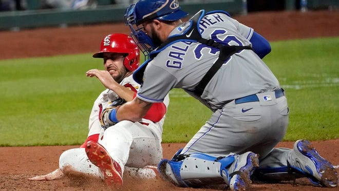 St. Louis Cardinals' Paul DeJong is tagged out at home by Kansas City Royals catcher Cam Gallagher (36) during the eighth inning of a baseball game Tuesday, Aug. 25, 2020, in St. Louis.