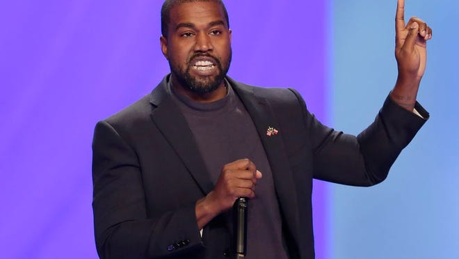 FILE - In this Sunday, Nov. 17, 2019, file photo, Kanye West answers questions during a service at Lakewood Church, in Houston.