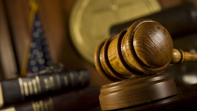 A gavel rests on a judge's bench.