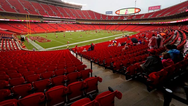 Fans watch the Kansas City Chiefs during NFL football training camp Saturday, Aug. 29, 2020, at Arrowhead Stadium in Kansas City, Mo. The Chiefs opened the stadium to 5,000 season ticket holders to watch practice as the team plans to open the regular season with a reduced capacity of approximately 22 percent of normal attendance.