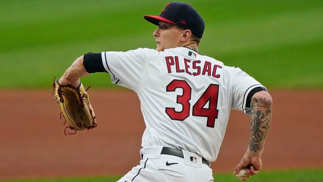 Cleveland Indians starting pitcher Zach Plesac delivers in the first inning of a baseball game against the Kansas City Royals, Monday, Sept. 7, 2020, in Cleveland.