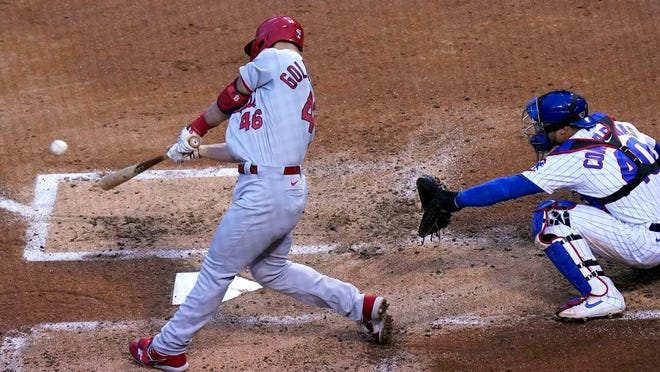 St. Louis Cardinals' Paul Goldschmidt, left, hits a three-run home run against the Chicago Cubs during the third inning of a baseball game in Chicago, Sunday, Sept. 6, 2020.