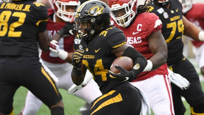 In this Nov. 29, 2019, file photo, Missouri running back Larry Rountree III finds a hole in the Arkansas defense as he runs the ball during the first half of an NCAA college football game in Little Rock, Ark.