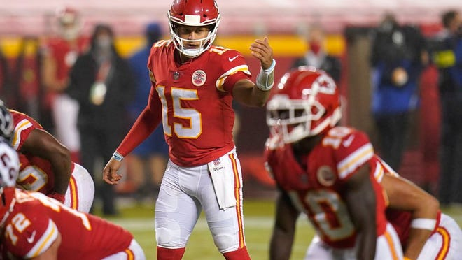 Kansas City Chiefs quarterback Patrick Mahomes (15) directs a teammate in the second half of an NFL football game against the Houston Texans Thursday, Sept. 10, 2020, in Kansas City, Mo.