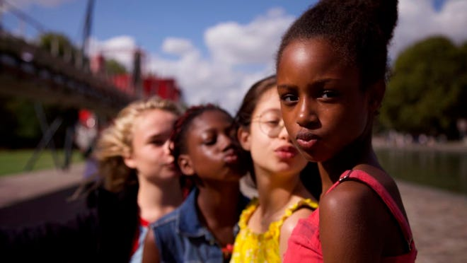 """This image released by Netflix shows the cast of the coming-of-age film """"Cuties,"""" streaming Wednesday, Sept. 9."""