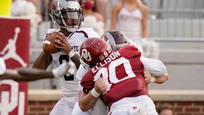 Missouri State quarterback Jaden Johnson, left, looks to pass in the first half of an NCAA college football game against Oklahoma Saturday, Sept. 12, 2020, in Norman, Okla.