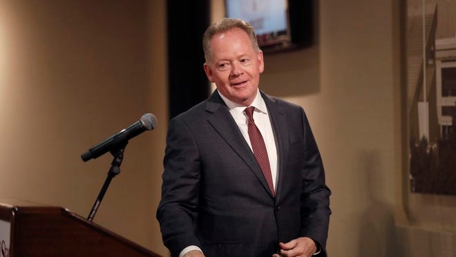 Bobby Petrino steps to the podium as he is introduced as the new football at Missouri State during a news conference Thursday, Jan. 16, 2020, in Springfield, Mo.
