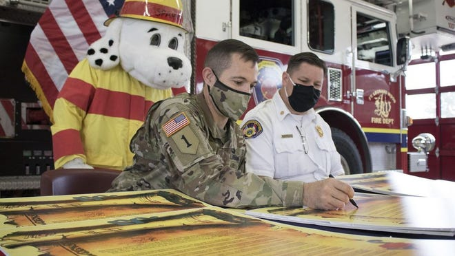 U.S. Army Garrison Fort Leonard Wood Commander Col. Jeff Paine (left) and Fort Leonard Wood Fire Chief Brad Bowling sign a proclamation Sept. 17 at Fire Station No. 1 in preparation for Fire Prevention Week, which is Oct. 4 through 10.