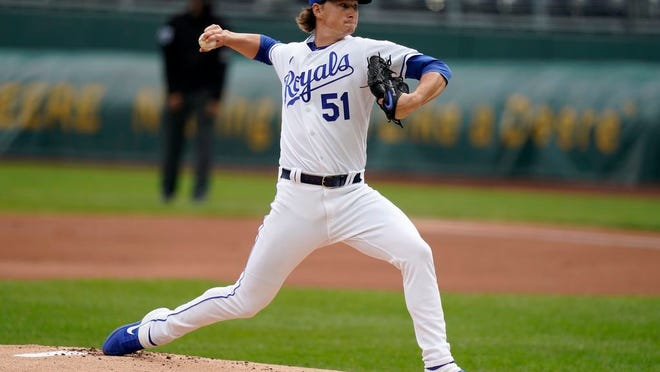 Kansas City Royals starting pitcher Brady Singer delivers to a Detroit Tigers batter during the first inning of a baseball game at Kauffman Stadium in Kansas City, Mo., Sunday, Sept. 27, 2020.