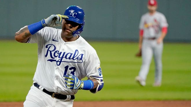Kansas City Royals' Salvador Perez celebrates as he runs the bases after hitting a two-run home run during the first inning of the team's baseball game against the St. Louis Cardinals on Wednesday, Sept. 23, 2020, in Kansas City, Mo.