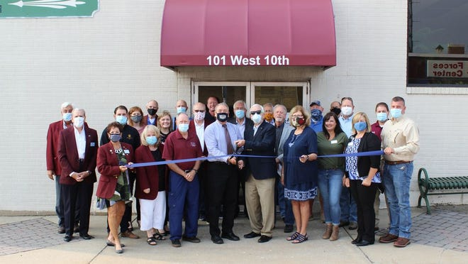 Holding the scissors is Executive Director Dale Martin at the commission's new location, 101 W. 10 St., Suite 1, in Rolla.