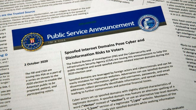 A public service announcement from the FBI and the Department of Homeland Security cybersecurity agency is photographed Tuesday, Oct. 6, 2020. The government agencies have issued a series of advisories in recent weeks aimed at warning voters about problems that could surface in the election -- as well as steps Americans can take to counter the foreign interference threat.