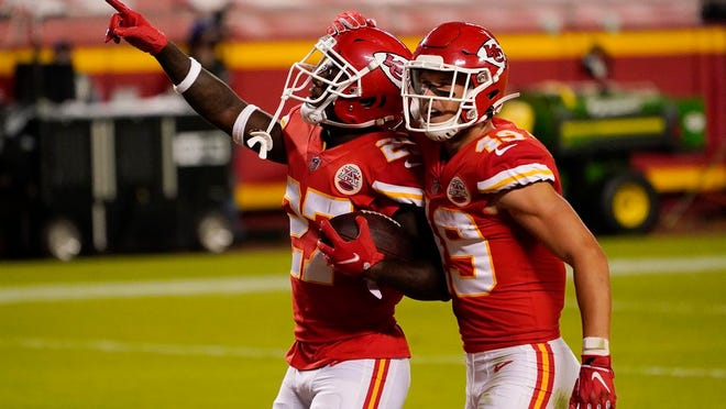 Kansas City Chiefs cornerback Rashad Fenton (27) celebrates with teammate Daniel Sorensen (49) after intercepting a pass during the second half of an NFL football game against the New England Patriots, Monday, Oct. 5, 2020, in Kansas City.