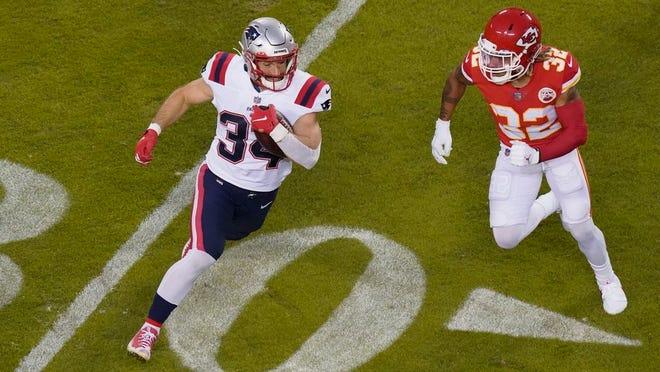 New England Patriots running back Rex Burkhead (34) runs from Kansas City Chiefs safety Tyrann Mathieu (32) during the first half of an NFL football game, Monday, Oct. 5, 2020, in Kansas City.