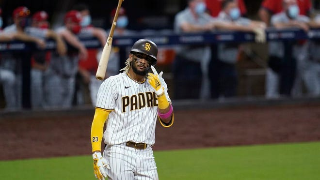 San Diego Padres' Fernando Tatis Jr. tosses his bat after hitting a two-run home run during the seventh inning of Game 2 of the team's National League wild-card baseball series against the St. Louis Cardinals, Thursday, Oct. 1, 2020, in San Diego.
