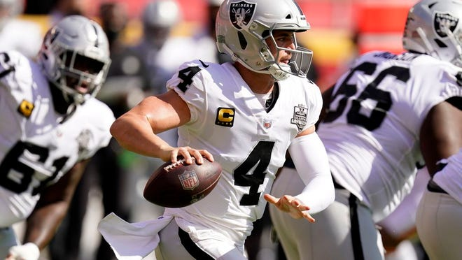 Las Vegas Raiders quarterback Derek Carr (4) looks to throw a pass during the first half of an NFL football game against the Kansas City Chiefs, Sunday, Oct. 11, 2020, in Kansas City.