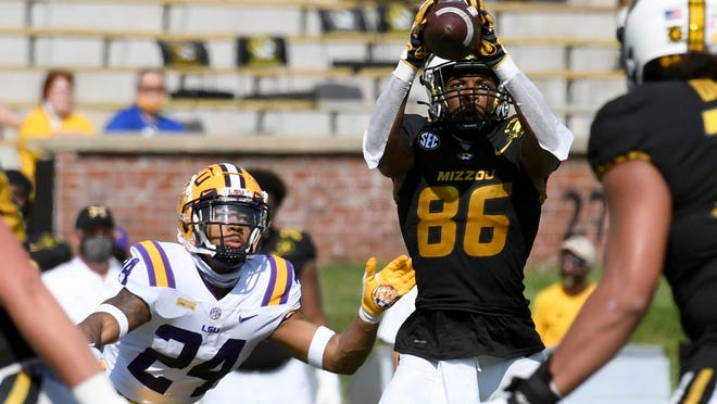 Missouri wide receiver Tauskie Dove (86) catches a pass as LSU cornerback Derek Stingley Jr. (24) defends during the first half of an NCAA college football game Saturday, Oct. 10, 2020, in Columbia, Mo.