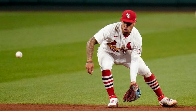 In this Sept. 11, 2020, file photo, St. Louis Cardinals second baseman Kolten Wong handles a sharp grounder by Cincinnati Reds' Nick Castellanos during the fifth inning of a baseball game in St. Louis.