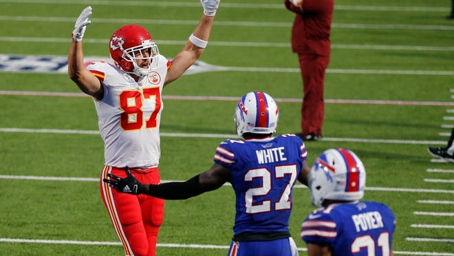 Kansas City Chiefs' Travis Kelce, left, celebrates his touchdown during the first half of an NFL football game against the Buffalo Bills, Monday, Oct. 19, 2020, in Orchard Park, N.Y.