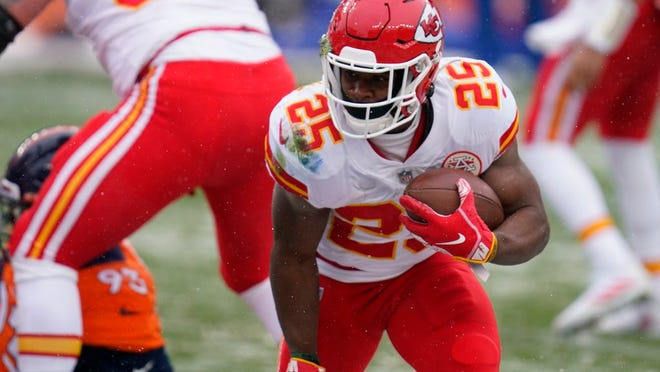 Kansas City Chiefs running back Clyde Edwards-Helaire runs for a touchdown during the first half of an NFL football game against the Denver Broncos, Sunday, Oct. 25, 2020, in Denver.