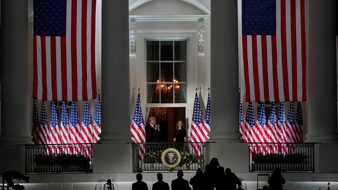 President Donald Trump and Amy Coney Barrett stand on the Blue Room Balcony after Supreme Court Justice Clarence Thomas administered her the Constitutional Oath on the South Lawn of the White House in Washington, Monday, Oct. 26, 2020.