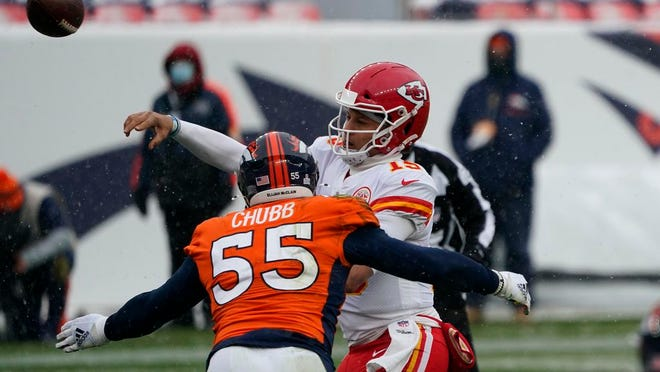 Kansas City Chiefs quarterback Patrick Mahomes throws a pass under pressure from Denver Broncos outside linebacker Bradley Chubb (55) during the first half of an NFL football game Sunday, Oct. 25, 2020, in Denver.