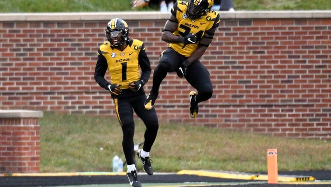 Missouri running back Larry Rountree III, right, celebrates with teammate Tyler Badie (1) after scoring on a 1-yard run during the second half of an NCAA college football game against Kentucky Saturday, Oct. 24, 2020, in Columbia, Mo.