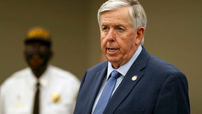 FILE - In this Aug. 6, 2020 file photo, Missouri Gov. Mike Parson speaks during a news conference in St. Louis. Gov.