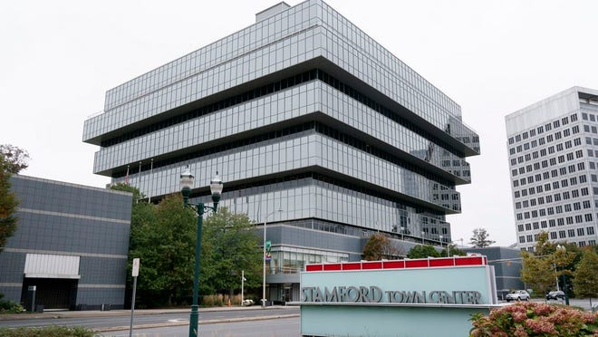 This Wednesday, Oct. 21, 2020 photo shows Purdue Pharma headquarters in Stamford, Conn. The Justice Department says on Wednesday, Purdue Pharma, the company that makes OxyContin, will plead guilty to three federal criminal charges as part of a settlement of more than $8 billion. OxyContin is the powerful prescription painkiller that experts say helped touch off an opioid epidemic.