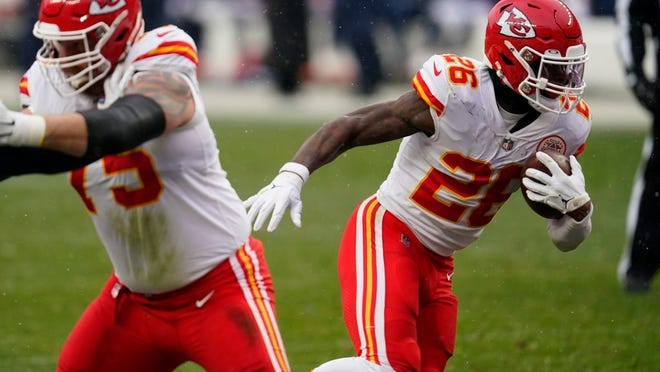 Kansas City Chiefs running back Le'Veon Bell, right, runs with the ball during the second half of an NFL football game against the Denver Broncos, Sunday, Oct. 25, 2020, in Denver.