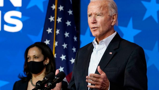Democratic presidential candidate former Vice President Joe Biden speaks Thursday, Nov. 5, 2020, in Wilmington, Del. Democratic vice presidential candidate Sen. Kamala Harris, D-Calif., stands at left.