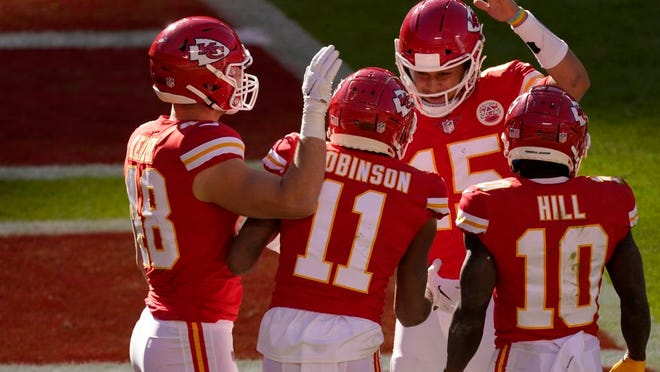 Kansas City Chiefs' Nick Keizer (48), Demarcus Robinson (11), Tyreek Hill (10) and Patrick Mahomes (15), celebrate a touchdown scored on a catch by Robinson in the second half of an NFL football game agains the New York Jets on Sunday, Nov. 1, 2020, in Kansas City, Mo.