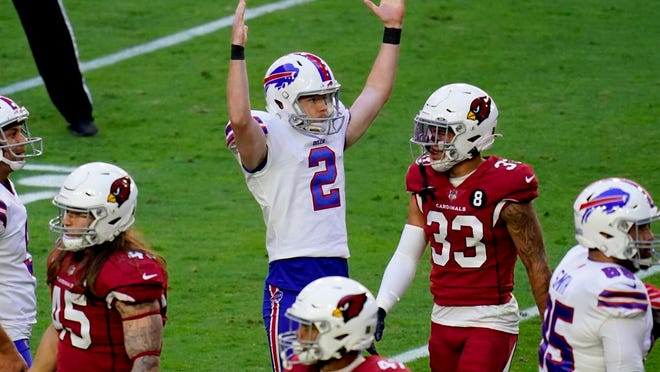Buffalo Bills kicker Tyler Bass (2) signlas his field goal is good during the first half of an NFL football game against the Arizona Cardinals, Sunday, Nov. 15, 2020, in Glendale, Ariz.