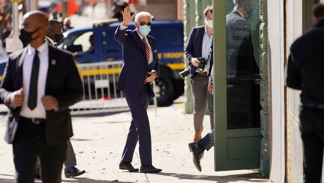 President-elect Joe Biden arrives to attend a briefing on the economy at The Queen theater, Monday, Nov. 16, 2020, in Wilmington, Del.