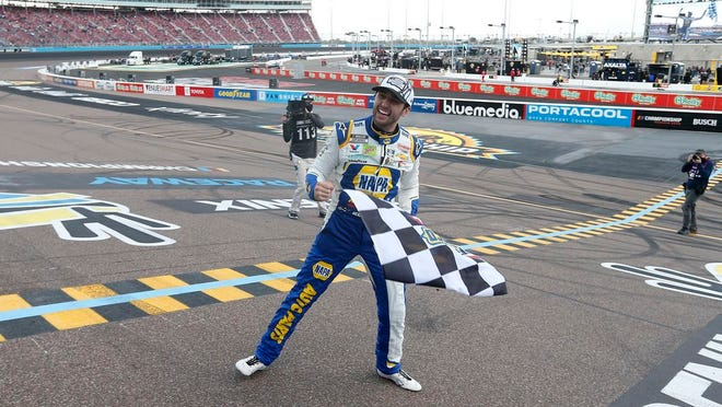 Chase Elliott celebrates at the finish line after winning the season championship and a NASCAR Cup Series auto race at Phoenix Raceway, Sunday, Nov. 8, 2020, in Avondale, Ariz.