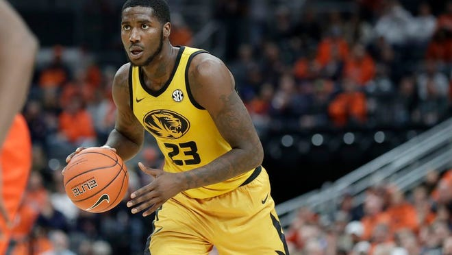 Missouri's Jeremiah Tilmon looks to pass during the second half of an NCAA college basketball game against Illinois in St. Louis, in this Saturday, Dec. 21, 2019, file photo. Tilmon flirted with the NBA before returning to Columbia.