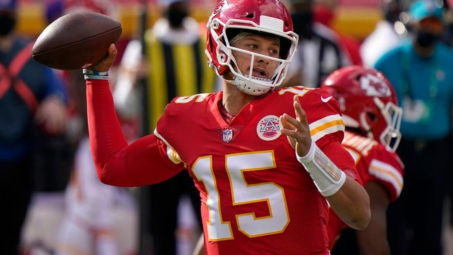 Kansas City Chiefs quarterback Patrick Mahomes (15) passes against the Carolina Panthers during the first half of an NFL football game in Kansas City, Mo., Sunday, Nov. 8, 2020.