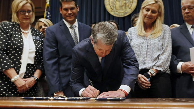 Georgia Gov. Brian Kemp signs legislation in May 2019 banning abortions once a fetal heartbeat can be detected.