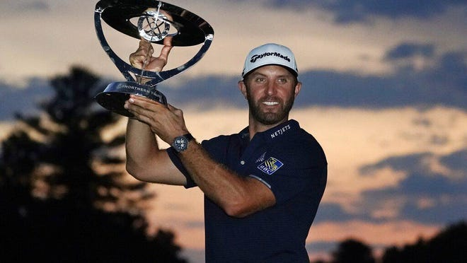 Dustin Johnson holds the trophy after winning the Northern Trust golf tournament at TPC Boston, Sunday, Aug. 23, 2020, in Norton, Mass.