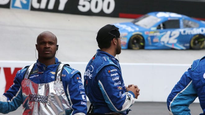 Former North Henderson High multi-sport standout Michael Roberts, the tire changer on the No. 42 team, watches Kyle Larson as he competes in the spring race at Bristol Motor Speedway in 2018.