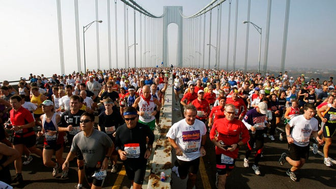 FILE - This is a Nov. 6, 2005, file photo showing runners on the upper level of the Verrazano Bridge at the start of the 36th New York City Marathon. The New York City Marathon scheduled for Nov. 1, 2020, has been cancelled because of the coronavirus pandemic. New York Road Runners announced the cancellation of the world's largest marathon Wednesday, June 24, 2020, after coordinating with the mayor's office and deciding the race posed too many health and safety concerns for runners, volunteers, spectators and others.