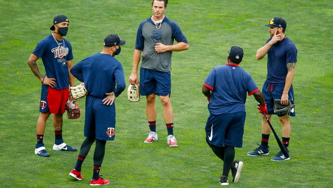 Minnesota Twins manager Rocco Baldelli, second from left, speaks with Eddie Rosario, Max Kepler, Tommy Watkins, and Jake Cave, left to right, at baseball camp Monday, July 6, 2020, in Minneapolis.