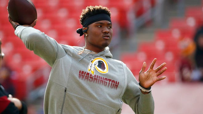 FILE - In this Dec. 22, 2019, file photo, Washington Redskins quarterback Dwayne Haskins works out prior to an NFL football game against the New York Giants, in Landover, Md. A new name must still be selected for the Washington Redskins football team, one of the oldest and most storied teams in the National Football League, and it was unclear how soon that will happen. But for now, arguably the most polarizing name in North American professional sports is gone at a time of reckoning over racial injustice, iconography and racism in the U.S.