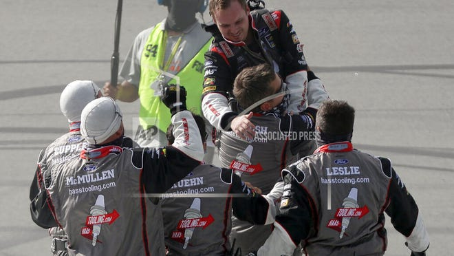 Cole Custer, top, celebrates with his crew after winning a NASCAR Cup Series auto race Sunday, July 12, 2020, in Sparta, Ky.