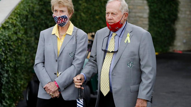 Jack Nicklaus, right, and his wife, Barbara, watch during the final round of the Memorial golf tournament, Sunday, July 19, 2020, in Dublin, Ohio.