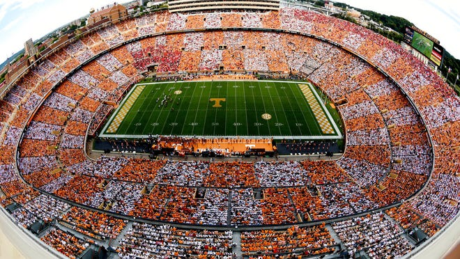 FILE - In this Sept. 30, 2017, file photo, a checkered pattern of colors made by fans is seen at Neyland Stadium during an NCAA college football game between Georgia and Tennessee, in Knoxville, Tenn. Tennessee will be selling tickets for approximately 25% of the seats at Neyland Stadium this season, officials announced Tuesday, Aug. 25, 2020. The Volunteers' first home game is Oct. 3 against Missouri and university officials say restrictions could change during the season based on statewide virus data and recommendations from public health officials.