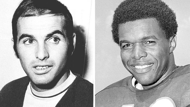 FILE - From left are 1970 file photos showing Brian Piccolo and Gale Sayers. Hall of Famer Gale Sayers, who made his mark as one of the NFL's best all-purpose running backs and was later celebrated for his enduring friendship with a Chicago Bears teammate with cancer, has died at age 77.