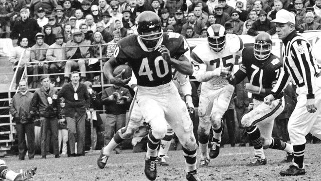 "FILE - In this Oct. 27, 1969, file photo, Chicago Bears running back Gale Sayers (40) runs for a 28-yard gain against the Los Angeles Rams, in Chicago, Ill. Hall of Famer Gale Sayers, who made his mark as one of the NFL's best all-purpose running backs and was later celebrated for his enduring friendship with a Chicago Bears teammate with cancer, has died. He was 77. Nicknamed ""The Kansas Comet†and considered among the best open-field runners the game has ever seen, Sayers died Wednesday, Sept. 23, 2020, according to the Pro Football Hall of Fame."