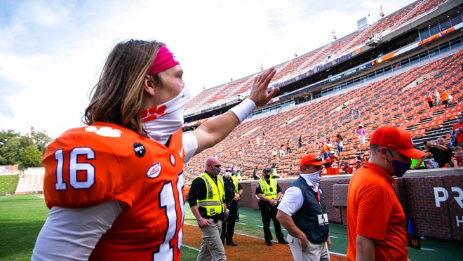 Clemson quarterback Trevor Lawrence (16) waves to fans after an NCAA college football game against Syracuse in Clemson, S.C., on Saturday, Oct. 24, 2020.